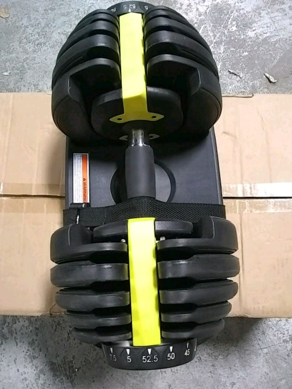 black and yellow selectorized dumbbell