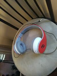 red and white corded headphones