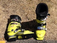 pair of yellow-and-black crispi ski boots