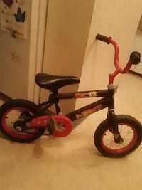 toddler's red and black bicycle brand new