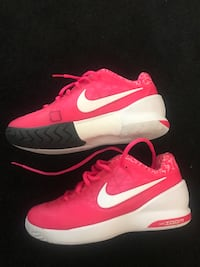 Pair of pink-and-white nike running shoes Portland, 97225
