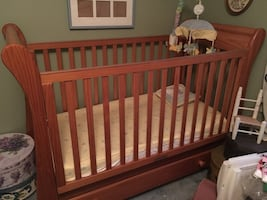 Crib with bedding and mobile