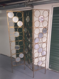 Stylish mirror and gold metal screen