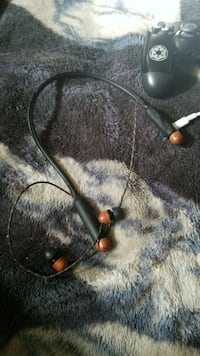 black with wood marley earbuds  Calgary, T3J 1X2