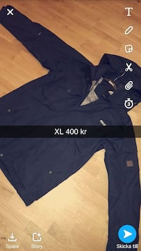 storlek XL blå zip-up windbreaker skärmdump