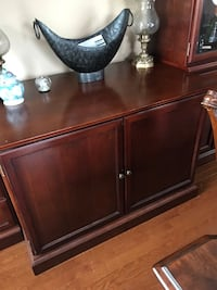 Large Bombay Tv entertainment center a few scratches on the top but great piece Raymond, 03077