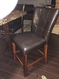 brown wooden framed black leather padded chair St Albert, T8N 3A6
