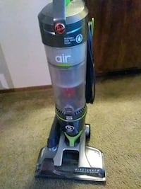 gray and black Hoover upright vacuum cleaner 2336 mi