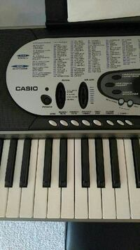 Casio electronic keyboard with stand and stool