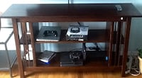 black wooden TV stand with shelf