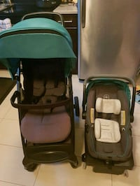 baby's black and green travel system Vancouver, V6J