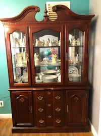 Dinning table, chairs and glass hutch from smoke and pet free home. Chesapeake, 23320