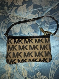 Authentic MK wristlet  1403 mi