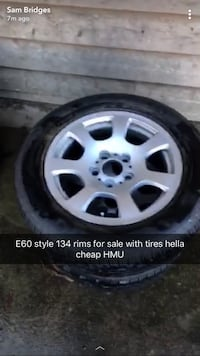 2 bmw style 134 rims with tires on them