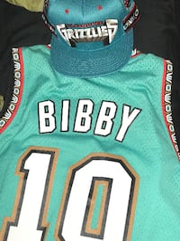 green and white Vancouver Grizzlies Bibby 10 jersey and cap
