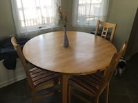 Round brown wooden table with four chairs dining set Locust Grove, 22508