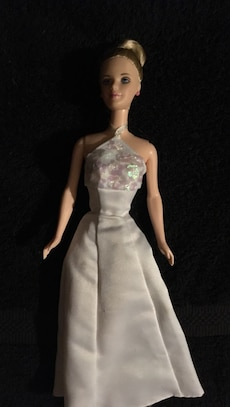 blond haired Barbie wearing white gown doll