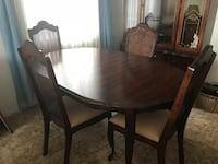 round brown wooden table with four chairs dining set Edmonton, T5Z 2K3