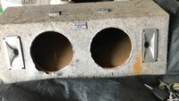 two round gray subwoofer enclosures Barberton, 44203