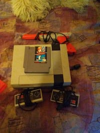 Nintendo 64 console with controller and game cartridges Lloydminster, T9V