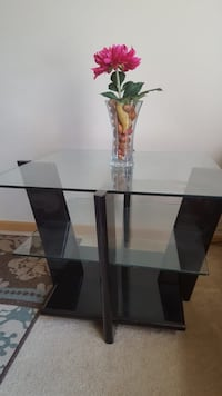 Square glass top 2 tier table with black wooden base 593 mi