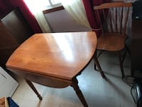 Real oak wood table, two lifts one on each side.