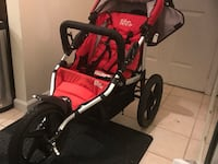 baby's red and black jogging stroller Rockville, 20850