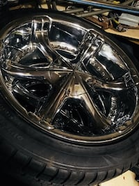 chrome-colored 6-spoke vehicle wheel and tire 17 mi