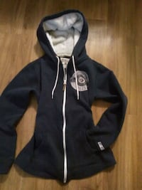 Black and white zip-up hoodie $10 Winnipeg, R2V 3G5