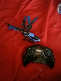 black and blue quadcopter with remote