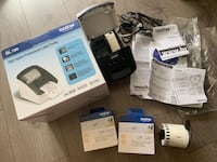 Brother QL-700 label printer with two rolls sealed labels