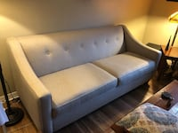 tufted blue and brown fabric sofa 336 mi