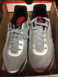 Pair of gray nike running shoes Lafayette, 70503