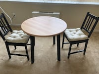 round brown wooden table with two chairs 41 km