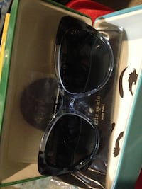 black framed Ray-Ban sunglasses 481 km