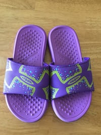 pair of purple-and-pink Nike slide sandals Commerce City, 80022