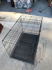Dog kennel, bed, training pads/holder Kennel and bed hardly used!
