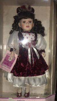 doll in red and white dress