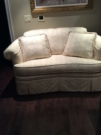 gray fabric loveseat with throw pillows