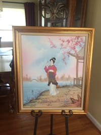 woman sitting on chair painting 13 km