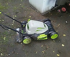 green and black push lawn mower
