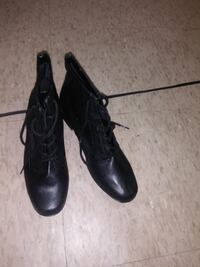 pair of black leather lace-up boots null