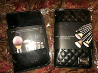 two black leather makeup brush pouches