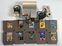 NES console with controller and game cartridges Germantown, 20876