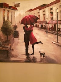 Couple kissing under the umbrella near puppy painnting Lincolnia, 22312