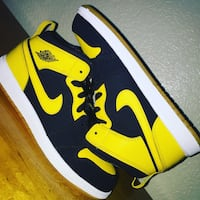 Pair of black-and-yellow nike basketball shoes  Fresno, 93727