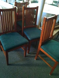 Table with 4 chairs. Table needs refinishing. South Bend, 46614