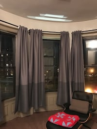 Curtains with blackout.  Perfect shape.   Includes curtain rods to hang them.   I 405 mi