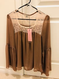 brown and white lace blouse 577 km