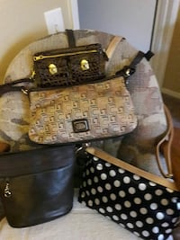 black leather sling and brown sling bag Las Vegas, 89101